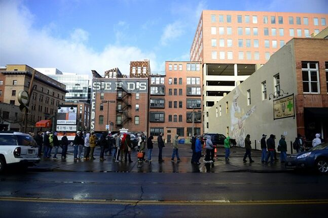 DENVER, CO - JANUARY 01: Customers wait in line, which was more than 300 deep by 10 a.m., on the first day of retail marijuana sales at LoDo Wellness in Denver Wednesday Jan. 1, 2014. Customers can legally purchase marijuana for recreation use in Colorado. (AP Photo/The Denver Post, AAron Ontiveroz ) MAGS OUT; TV OUT; INTERNET OUT; NO SALES; NEW YORK POST OUT; NEW YORK DAILY NEWS OUT