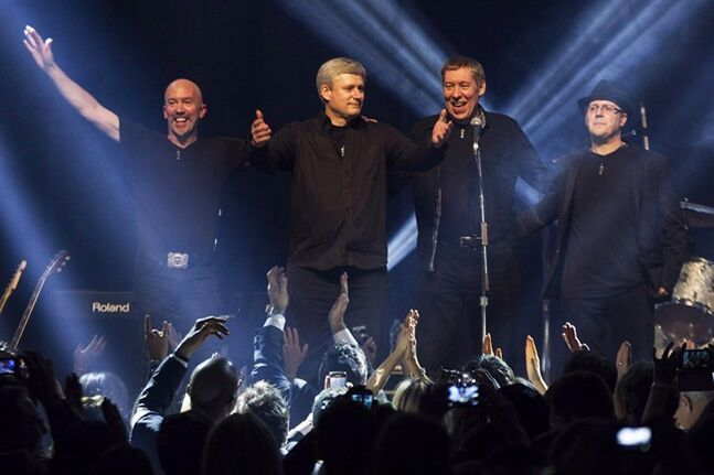 Phil Nolan (far right) who plays drums in the band that often accompanies Prime Minister Stephen Harper, is facing multiple charges of sexual assault and sexual interference. Harper and his band Herringbone receive applause after performing in Toronto on Sunday, December 1, 2013. THE CANADIAN PRESS/Chris Young