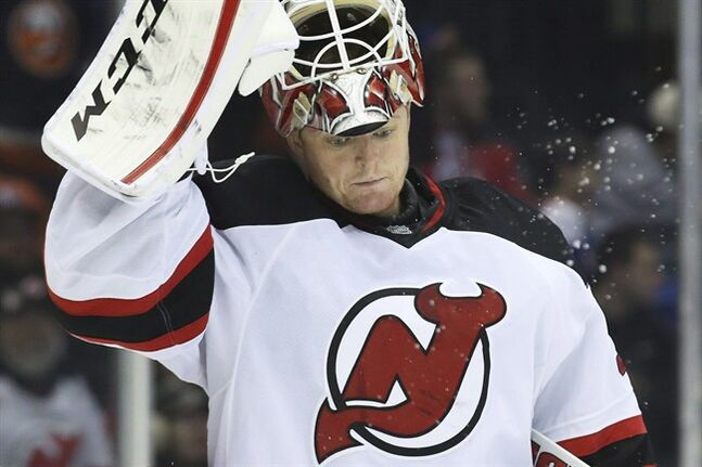 New Jersey Devils goalie Cory Schneider (35) reacts in the second period of an NHL hockey game against the New York Islanders, Saturday, March 29, 2014, in Uniondale, N.Y. The Devils have re-signed Schneider to a multi-year contract. THE CANADIAN PRESS/AP/John Minchillo