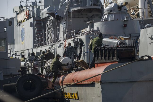Pro-Russian forces seize the Ukrainian ship Khmelnitsky in Sevastopol, Crimea, on Thursday.
