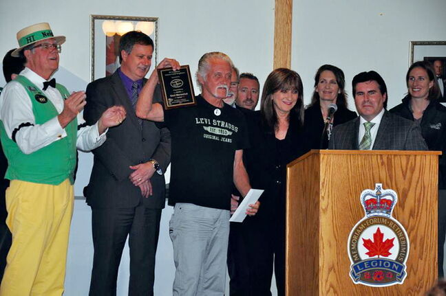 Emil Werestiuk receives his Good Neighbour Award on May 31.