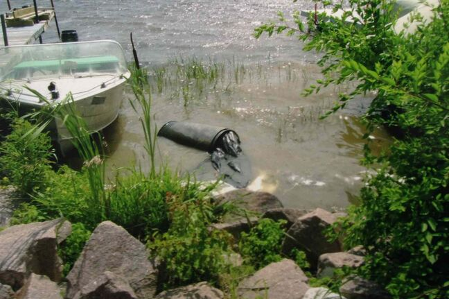 A barrel containing the body of Chad Davis is seen on the Lee River on July 23, 2008.
