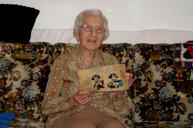 Doris Chonstke displays the birthday card she and her friend, Netti Kulik, have been mailing back and forth to each other for more than 50 years.