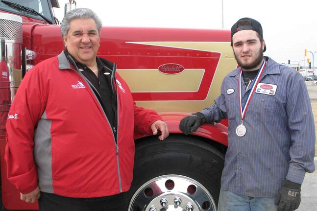Maples Collegiate instructor Lawrence Danylchuk (left) and Jonathan Amaral, a silver medal winner in car painting at the Skills Manitoba Competition on April 10 at Red River College's Notre Dame campus