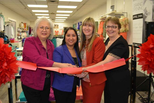 (From left to right) Northern Reflections store manager Patricia Lavallee, Old Kildonan councillor Devi Sharma, district sales manager Fay Hurd and Burrows MLA Melanie Wight cut the ribbon at the grand opening celebration of a Northern Reflections location in the Garden City Shopping Centre on April 24.