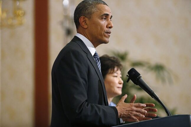 U.S. President Barack Obama and South Korean President Park Geun-hye attend a joint news conference at the Blue House in Seoul, South Korea, Friday, April 25, 2014. Obama, continuing his four-nation Asia trip which began in Japan, is expected to underscore warnings against North Korean nuclear provocations, calls to lower tensions in regional territorial disputes, and words of condolence for the ferry disaster victims and the people of South Korea. (AP Photo/Charles Dharapak)