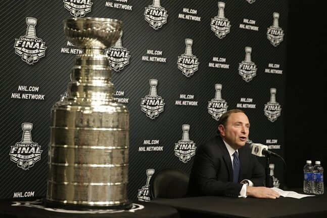 NHL commissioner Gary Bettman speaks during a news conference before Game 1 of the NHL Stanley Cup Final hockey series between the Los Angeles Kings and the New York Rangers on Wednesday, June 4, 2014, in Los Angeles. (AP Photo/Jae C. Hong)