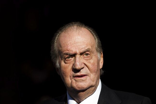 FILE - In this Tuesday, Dec. 27, 2011, file photo Spain's King Juan Carlos leaves after the official opening of the Parliament, in Madrid. Spain's King Juan Carlos plans to abdicate and pave the way for his son, Crown Prince Felipe, to take over, Spanish Prime Minister Mariano Rajoy told the country Monday in an announcement broadcast nationwide. The 76-year-old Juan Carlos oversaw his country's transition from dictatorship to democracy but has had repeated health problems in recent years. (AP Photo/Daniel Ochoa de Olza, File)