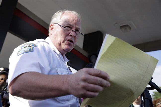 Ferguson Police Chief Thomas Jackson releases the name of the the officer accused of fatally shooting Michael Brown, an unarmed teenager, Friday, Aug. 15, 2014, in Ferguson, Mo. Jackson announced that the officer's name is Darren Wilson. (AP Photo/Jeff Roberson)