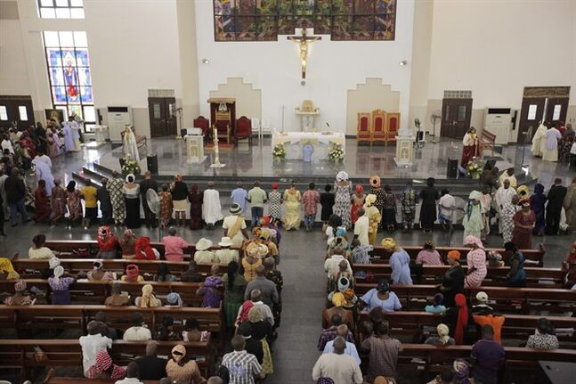 Catholic faithful attend a morning Mass given in honour of the kidnapped Chibok schoolgirls, in Abuja, Nigeria, Sunday May 11, 2014. The failure to rescue the kidnapped girl students who remain captive after some four weeks has attracted mounting national and international outrage, and one of the teenagers who escaped from the Islamic extremists who abducted the hundreds of schoolgirls, science student Sarah Lawan said Sunday in an interview with The Associated Press the kidnapping was