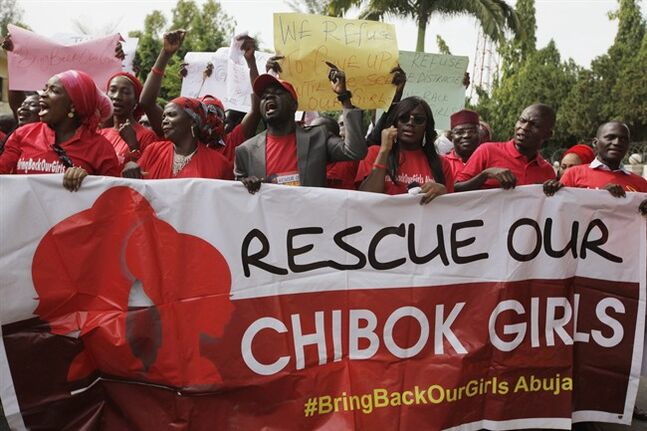 Women attend a demonstration calling on the government to rescue the kidnapped schoolgirls of the Chibok secondary school, in Abuja, Nigeria, Tuesday, May 13, 2014. A Nigerian government official said