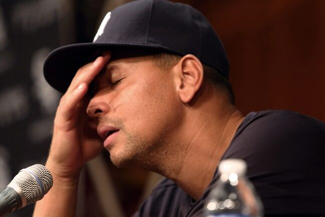 FILE - In this Aug. 5, 2013 file photo, New York Yankees' Alex Rodriguez, with his hand to his head, talks during a news conference before the Yankees played the Chicago White Sox in a baseball game at US Cellular Field in Chicago. The owner of a now-defunct Florida clinic was charged Tuesday, Aug. 5, 2014, with conspiracy to distribute steroids, more than a year after he was accused of providing performance-enhancing drugs to Yankees star Alex Rodriguez and other players. Federal court records show Anthony Bosch is charged with one count of conspiracy to distribute testosterone. (AP Photo/Charles Cherney, File)