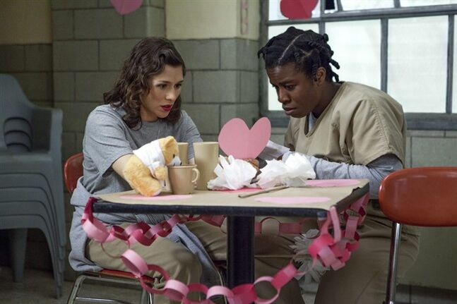 "This image released by Netflix shows Yael Stone, left, and Uzo Aduba in a scene from ""Orange is the New Black."" The second season of the prison series will be available on Friday, June 6, on Netflix. (AP Photo/Netflix, K.C. Bailey)"