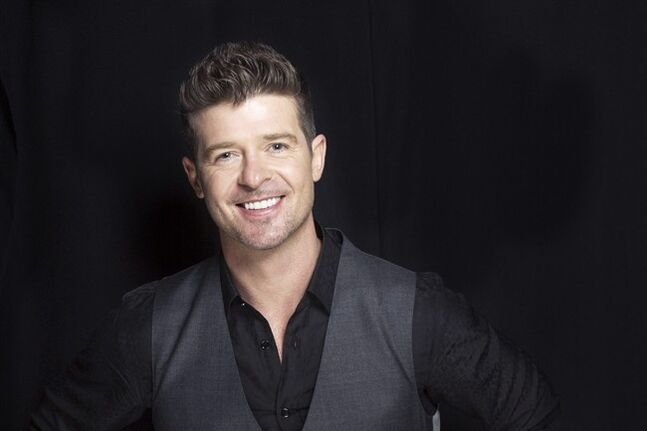 "FILE - This Aug. 1, 2013 file photo shows R&B singer-songwriter Robin Thicke in New York. The crooner's new album, ""Paula,"" only sold 24,000 units in its debut week in the United States. It's a far cry from his ""Blurred Lines"" album, which sold 177,000 units when it debuted last July. (Photo by Victoria Will/Invision/AP, File)"
