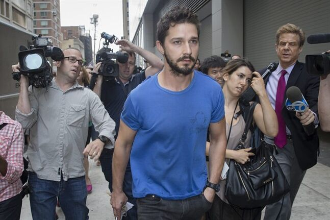 FILE - This June 27, 2014 file photo shows actor Shia LaBeouf walks through the media after leaving Midtown Community Court following his arrest the previous day for yelling obscenities at the Broadway show