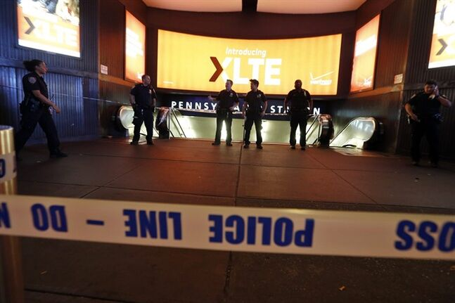 Police block the entrance to New York's Penn Station after reports of a suspicious package on board a Long Island Railroad train caused the station to be evacuated, Thursday, June 5, 2014. A spokesman for the Metropolitan Transportation Authority says the suspicious package was reported at about 10 p.m Thursday. (AP Photo/Jason DeCrow)