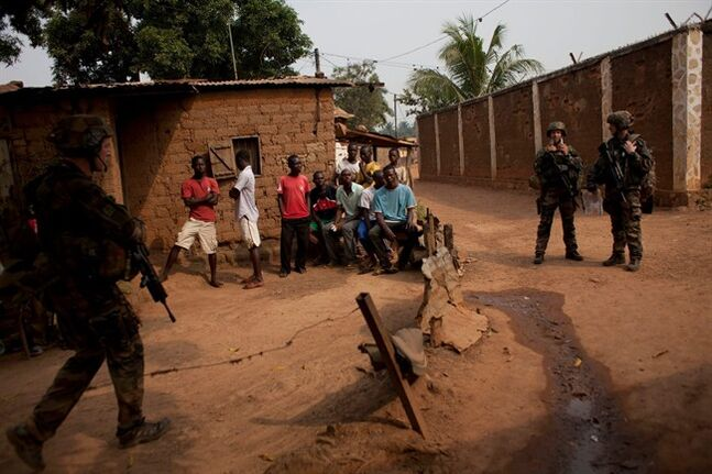 French troops secure a neighborhood in the Miskine district of Bangui, Central African Republic, Thursday, Dec. 26, 2013. The spokesman for an African Union peacekeeping force says six Chadian peacekeepers were killed and 15 were wounded, after being attacked Wednesday.(AP Photo/Rebecca Blackwell)