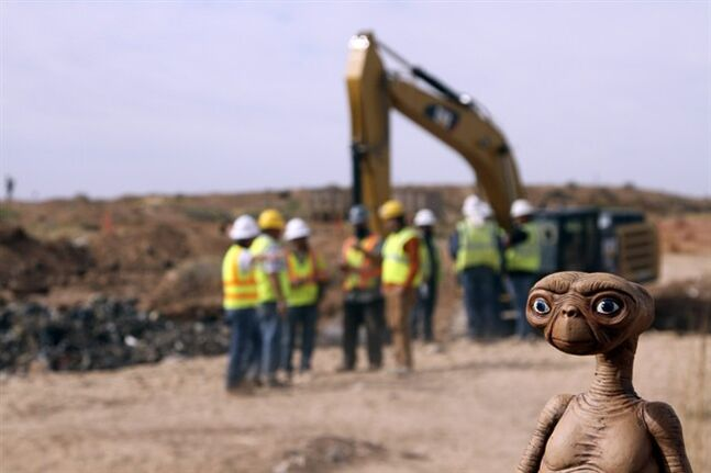 FILE - In this April 26, 2014 file photo, an E.T. doll is seen while construction workers prepare to dig into a landfill in Alamogordo, N.M., Producers of a documentary dug in an southeastern New Mexico landfill in search of millions of cartridges of the Atari 'E.T. the Extra-Terrestrial' game that has been called the worst game in the history of video gaming and were buried there in 1983. Officials in Alamogordo, are working on a plan under which film companies, museums and the public could get Atari video games that were dug up from the old landfill last month. (AP Photo/Juan Carlos Llorca)