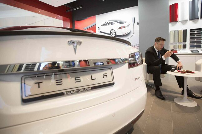 Tesla became a rarity when CEO Elon Musk pledged that its auto inventions will be free for anyone to use 'in good faith'; Musk wants to apply the contrarian style that has already made him millions of dollars to revolutionize the litigious world of patents.