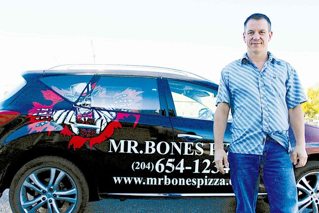 "Harold Brazil, founder of Mr. Bones Pizza, with the ""Bonesmobile."" Brazil is working on resurrecting the pizza restaurant, which will operate out of 1027 McPhillips St."
