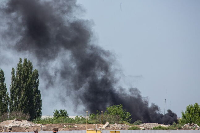 Smoke rises outside Donetsk International Airport in Donetsk, Ukraine, on May 26, after pro-Russian separatist rebels seized the facility. The Ukrainian military launched an offensive to recapture the airport, bringing in combat helicopters and warplanes.