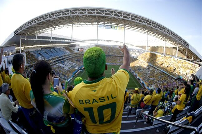 FILE - In this June 12, 2014 file photo taken with a fisheye lens, a Brazil supporter attends the World Cup opening match between Brazil and Croatia at Itaquerao Stadium in Sao Paulo, Brazil. FIFA's number two official has said he's