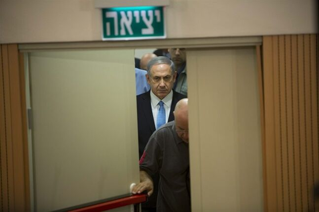 Israeli Prime Minister Benjamin Netanyahu arrives for a press conference at the defense ministry in Tel Aviv, Israel, Saturday Aug. 2, 2014. Netanyahu warned Hamas on Saturday that it will