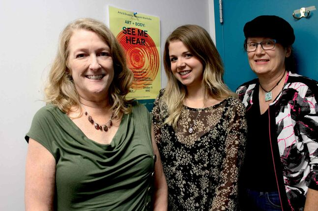 Cara Mason (centre) and Alice Crawford (right) are artists featured in this year's Art + Body festival, with works in the St. Boniface Library. Susan Lamberd (left) says artists like Mason and Crawford have unique perspectives on life and art because of their disabilities.