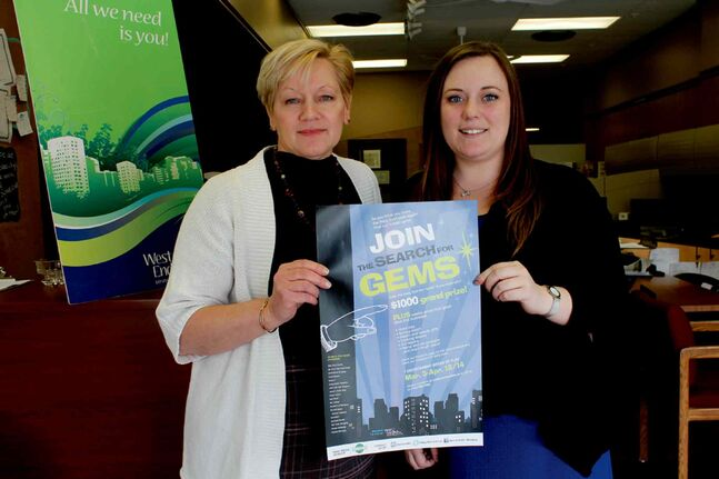 "Gloria Cardwell-Hoeppner (left) and Melissa Suggitt are seen holding the poster advertising the West End BIZ's second ""Search for Gems"" contest, running from March 3 to April 18."