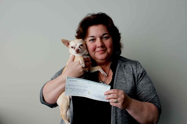 Carla Martinelli-Irvine, founder of the Winnipeg Pet Rescue Shelter, and her chihuahua Tiny Tim are thrilled about the $3,141.03 donated to the shelter. The money will go towards surgeries for animals with frostbite.