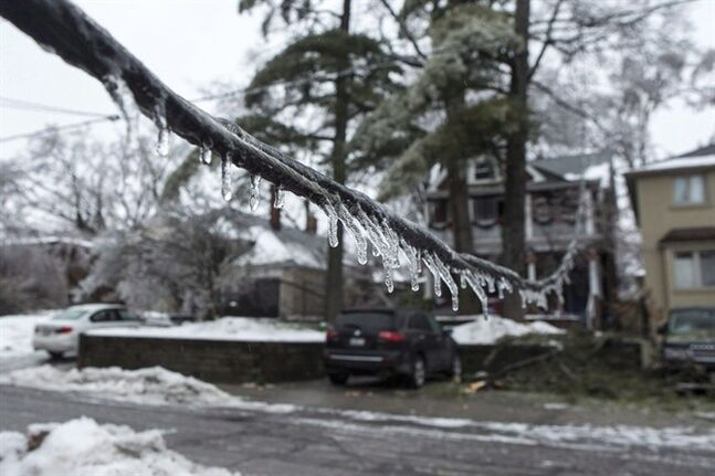Icicles hang from a downed power line on a residential street in Toronto as over 250,000 people face up to 72 hours without electricity after a storm brought heavy ice rain, on Sunday, December 22, 2013. Ice, floods and thunderstorms made 2013 the worst year ever for insured losses in Canada. THE CANADIAN PRESS/Chris Young