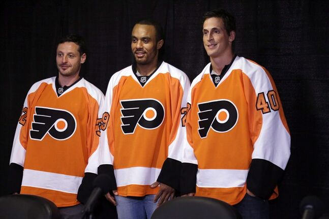 Philadelphia Flyers newest acquisitions, from left, Mark Streit, Ray Emery, and Vincent Lecavalier pose for photographs during an NHL hockey news conference in Philadelphia, July 9, 2013. Uncharacteristically out of the playoffs last season, the frustrated Flyers turned their summer into a game of fantasy hockey.Time will tell if they win that game THE CANADIAN PRESS/AP/Matt Rourke