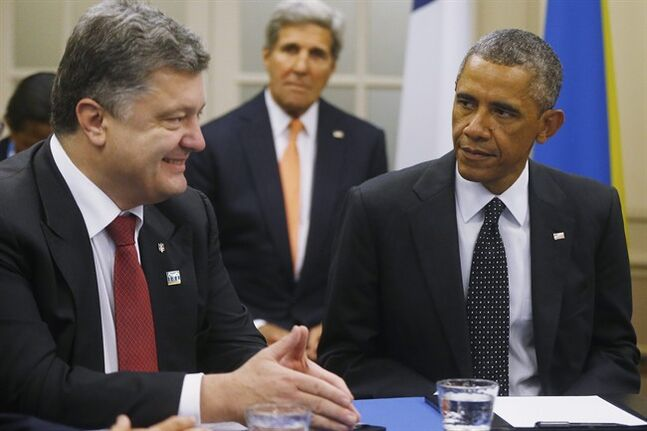 U.S. President Barack Obama is seated with Ukraine President Petro Poroshenko as they meet with other countries regarding Ukraine at the NATO summit at Celtic Manor in Newport, Wales, Thursday, Sept. 4, 2014. THE CANADIAN PRESS/AP, Charles Dharapak