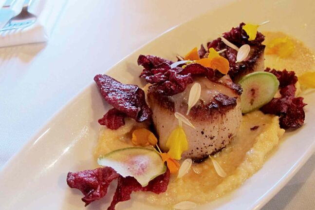 The kitchen at chew cook their enormous sea scallops exactly the way our reviewer likes them — crusty on the outside, barely cooked on the inside. The scallops are served with a saffron-infused cauliflower puree and crispy beet chips.