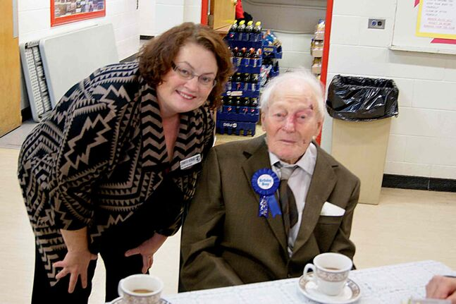 Jennifer Howard, MLA for Fort Rouge, with Ernest John Cruse celebrating his 99th birthday at the Seniors' Tea held at Earl Grey Community Centre on Oct. 16.