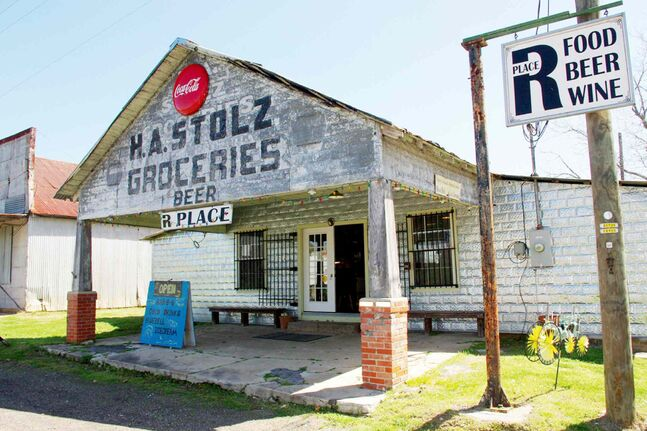 R Place, located in Texas' Washington County, bears the appearance of a 1920s machine shop. Inside, however, you'll find the region's most mouth-watering barbecue.