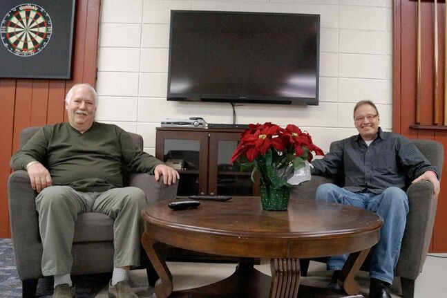 Con Gislason (left) and Dale Karasiuk relax in the expansive, comfortable room they've set up at the Elmwood East Kildonan Active Living Centre. The two are inviting the local 55+ community to come out and take in the Jets/Oilers game on Jan. 18.