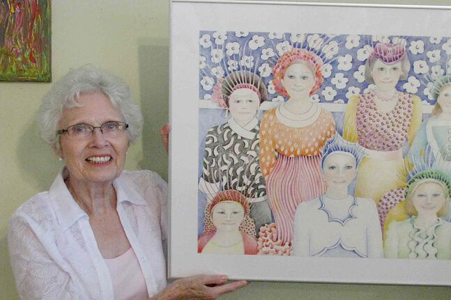 Jean Wiens with some of her art.