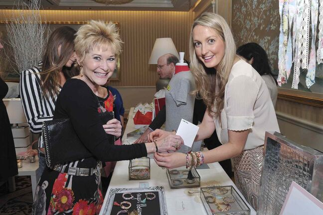 Actress Dee Wallace (left) and Sugar Blossom Design's Kelli Miller pictured at the second annual Oh Canada Gift Lounge at The Peninsula Beverly Hills hotel on Fri., Jan. 10, where Miller was showcasing her bracelets to Hollywood's glitterati.