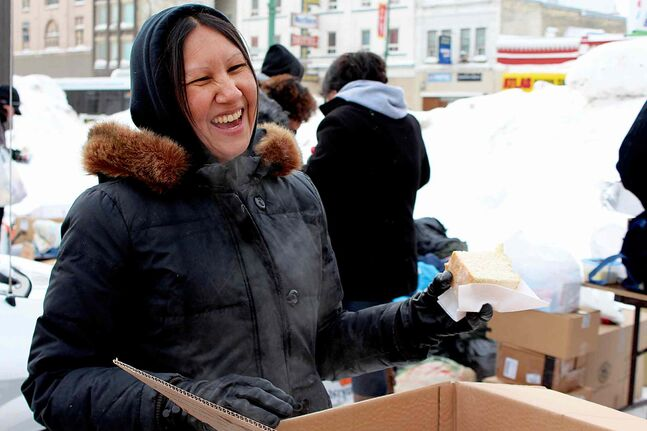 "Althea Guiboche celebrated one year of bringing the bannock on Thurs., Jan. 30 outside Neechi Commons (865 Main St.). Dubbed ""The Bannock Lady,"" Guiboche sets up at Main Street and Dufferin Avenue every Thursday afternoon and serves homemade bannock and soup to Winnipeg's hungry and homeless. The 39-year-old mother of seven was one of five recipients of the 2013 Manitoba Heroes Award in October. The one-year anniversary party featured a free bannock and chili lunch, hot chocolate, live entertainment and a warm clothing giveaway."