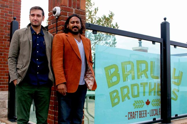 General manager Paulo Brochado (left) stands next to beer manager Raj Maniar at the future site of Barley Brothers (655 Empress St.). The restaurant will be open to the public on Oct. 25.