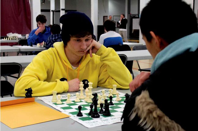 Cameron Comte (left) from Sturgeon Heights Collegiate and Martin Yin from John Taylor Collegiate ponder their strategies.