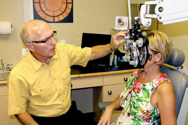 Dr. Don Porter gives a client an eye exam. Porter is one of several optometrists at 20/20 Eye Care taking part in the World Sight Day Challenge on Oct. 9 and 10.