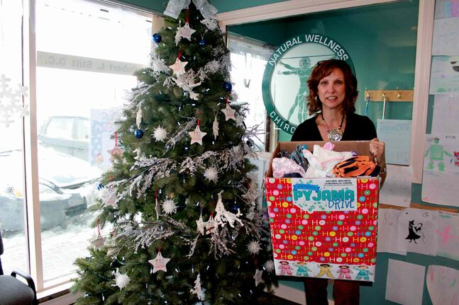Jammie Drive organizer Suzanne Stitt is holding a hamper of donated pyjamas.