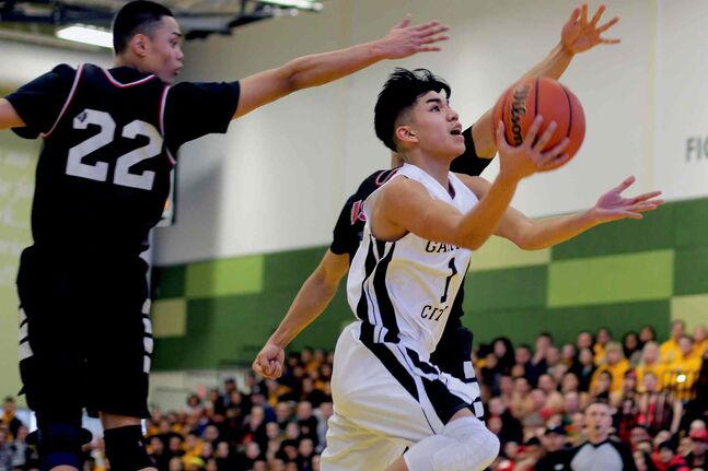 Garden City Fighting Gophers guard Byron Oduca in action against the Sisler Spartans during the quarterfinals of the AAAA Boys Basketball Provincials on Sat., March 15.