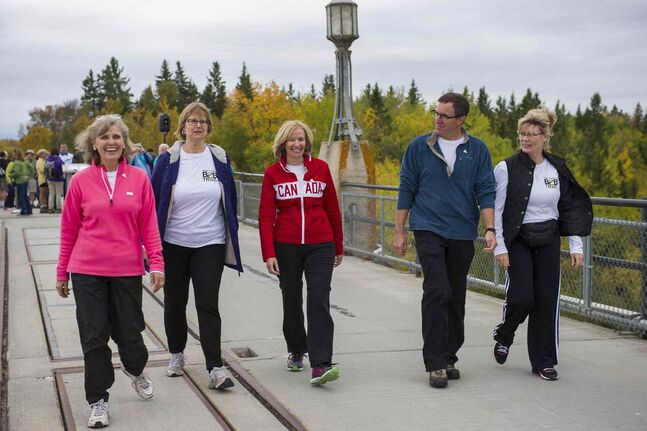 (L-R) President and CEO of the Trans Canada Trail, Deborah Apps, VP Corporate Relations for Manitoba Hydro, Ruth Kristjanson, Honourary Campaign Chair of the Trans Canada Trail, Laureen Harper, President of Trails Manitoba, Ian Hughes, and Minister of Canadian Heritage and Official Languages, Shelly Glover hike the new section of Border to Beaches trail in the Whiteshell Provincial Park Friday afternoon.