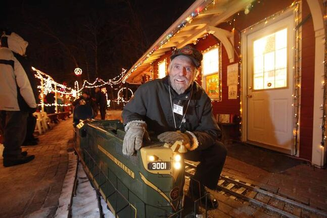 Bill Taylor, president of the Assiniboine Valley Railway, is known for his miniature railway, seen here all decked out for the Christmas season. Taylor died this week at 68.