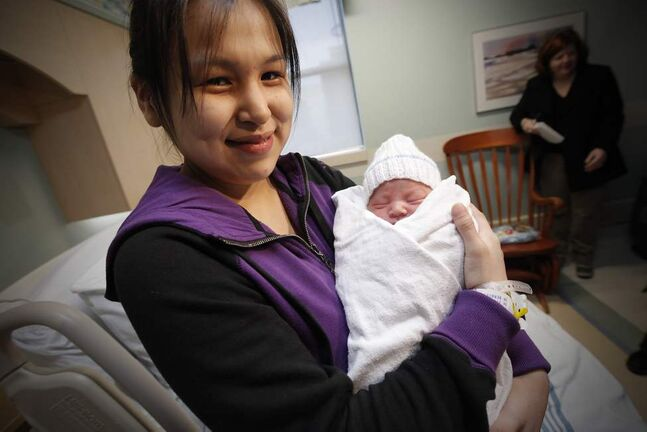 Anne Rose Aulatjut holds her baby Noah Nicholas Nehemiah at the Women's Hospital at HSC Sunday, January 1, 2012. Baby Noah is Winnipeg's New Year Baby. John Woods / Winnipeg Free Press
