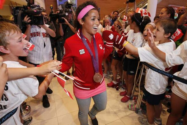 Soccer Olympian and bronze medalist Desiree Scott is welcomed home at Winnipeg Richardson International Airport. (John Woods / Winnipeg Free Press)