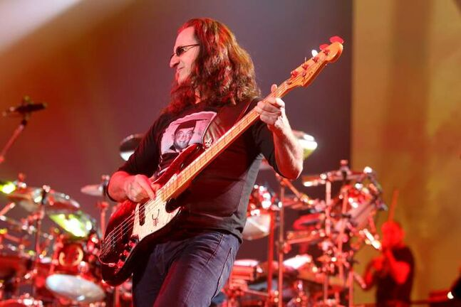 Rush lead vocalist Geddy Lee performs with his band on stage at the MTS Centre Wednesday evening.